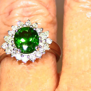 Tsavorite garnet and diamond platinum engagement ring