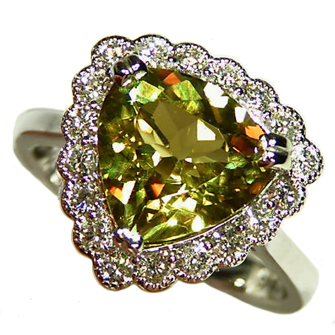 Natural color change Zultanite gold ring with diamond halo