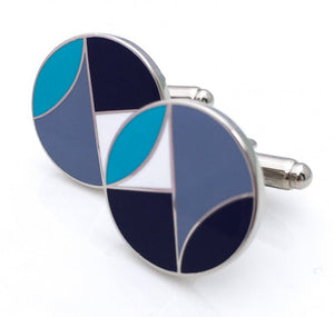 Round cufflinks with navy, blue, and white geometric design.