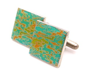 Silver square cufflinks in mint, green, and orange design.