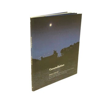 Book cover with photo of Bannerman Castle at night.