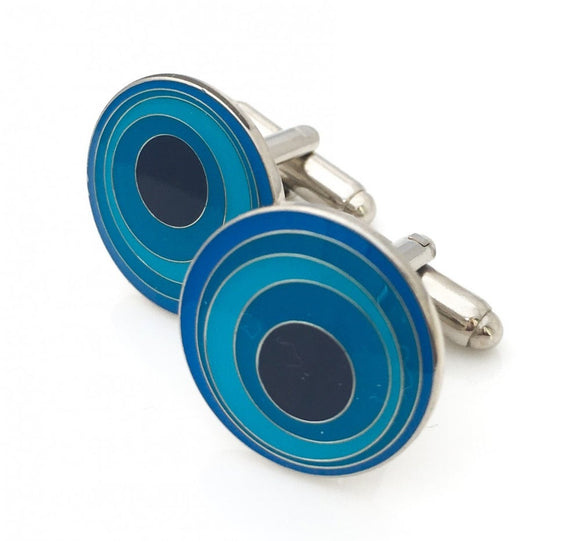 Round cufflinks with blue circular pattern.