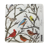 Rounded-square trivet of four connected glass coasters with year-round birds in tree branches.