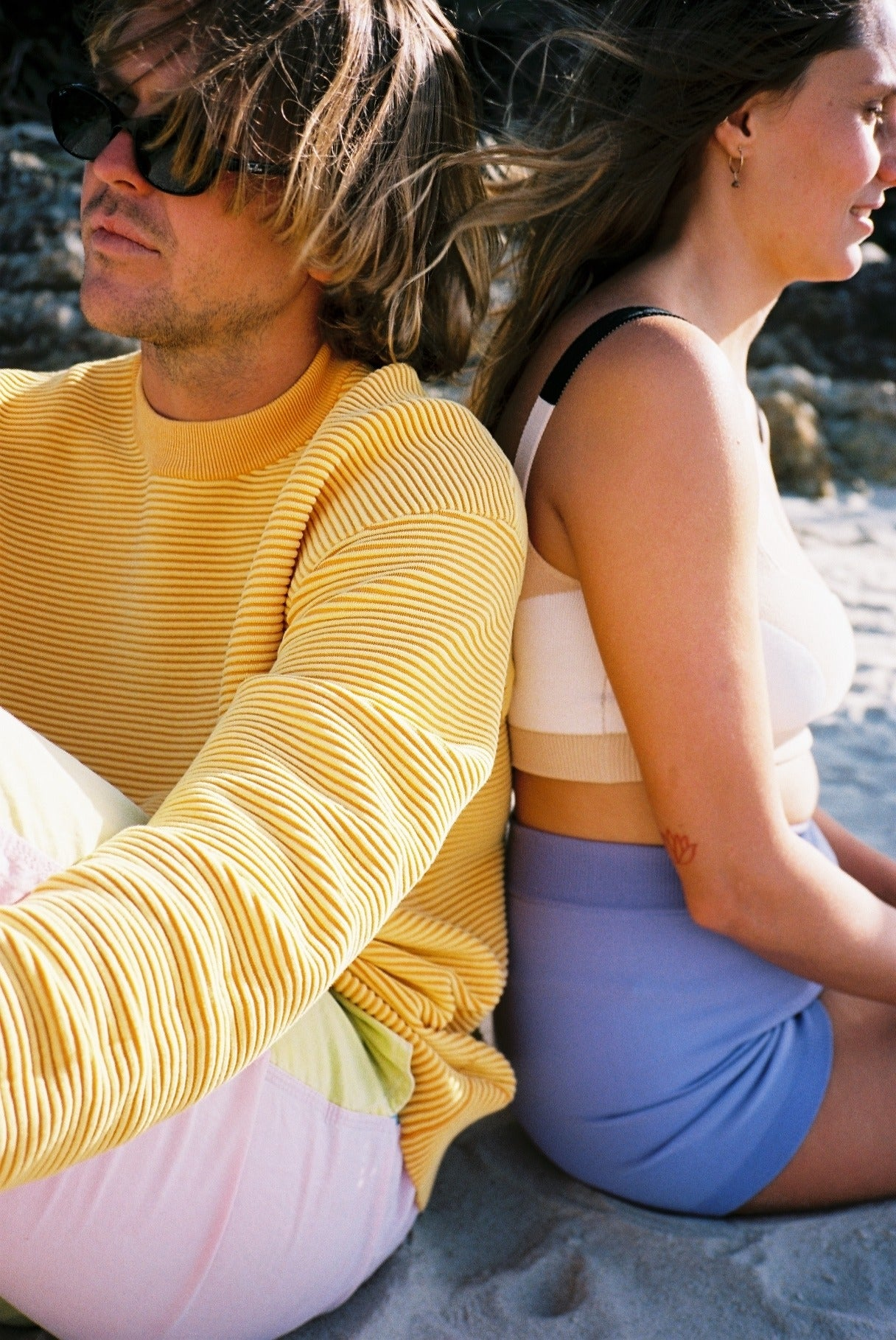 girl wears nami side stripe leotard in lilac and cropped rib sweater in tropic green black