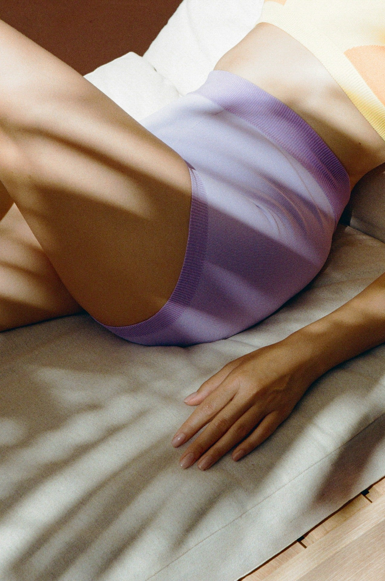 girl wears nami side stripe leotard in lilac