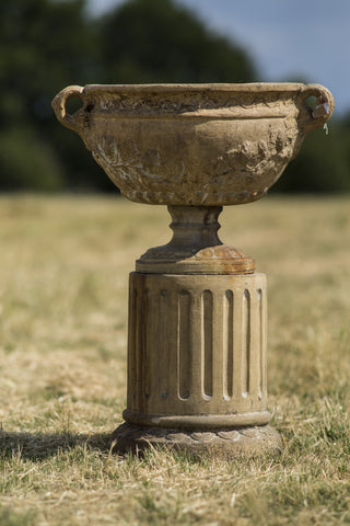 Pair of Antique Terracotta Urns on Plinths.