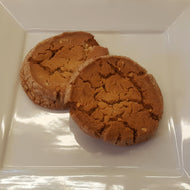 Two peanut butter cookies on a white plate.