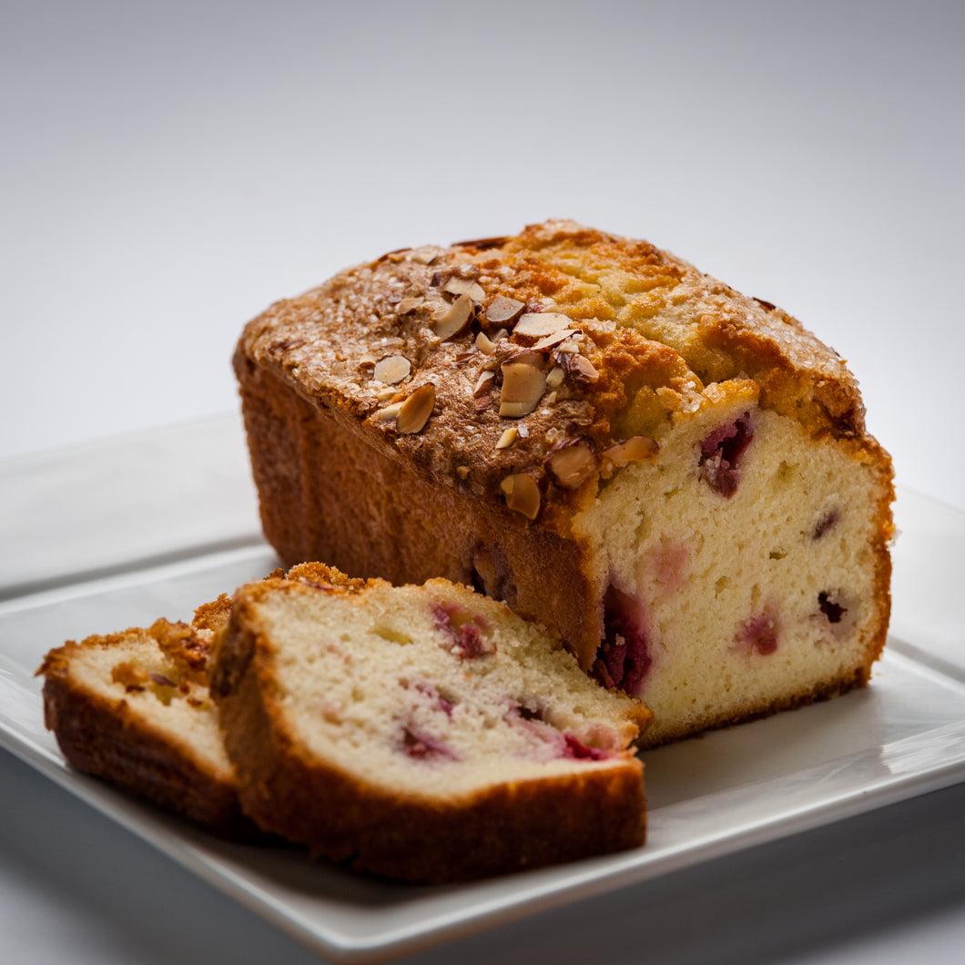 Slices of cherry almond bread on a white plate.