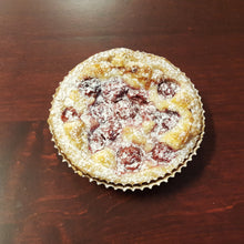 Load image into Gallery viewer, Cherry frangipane tart topped with cherries, and powdered sugar