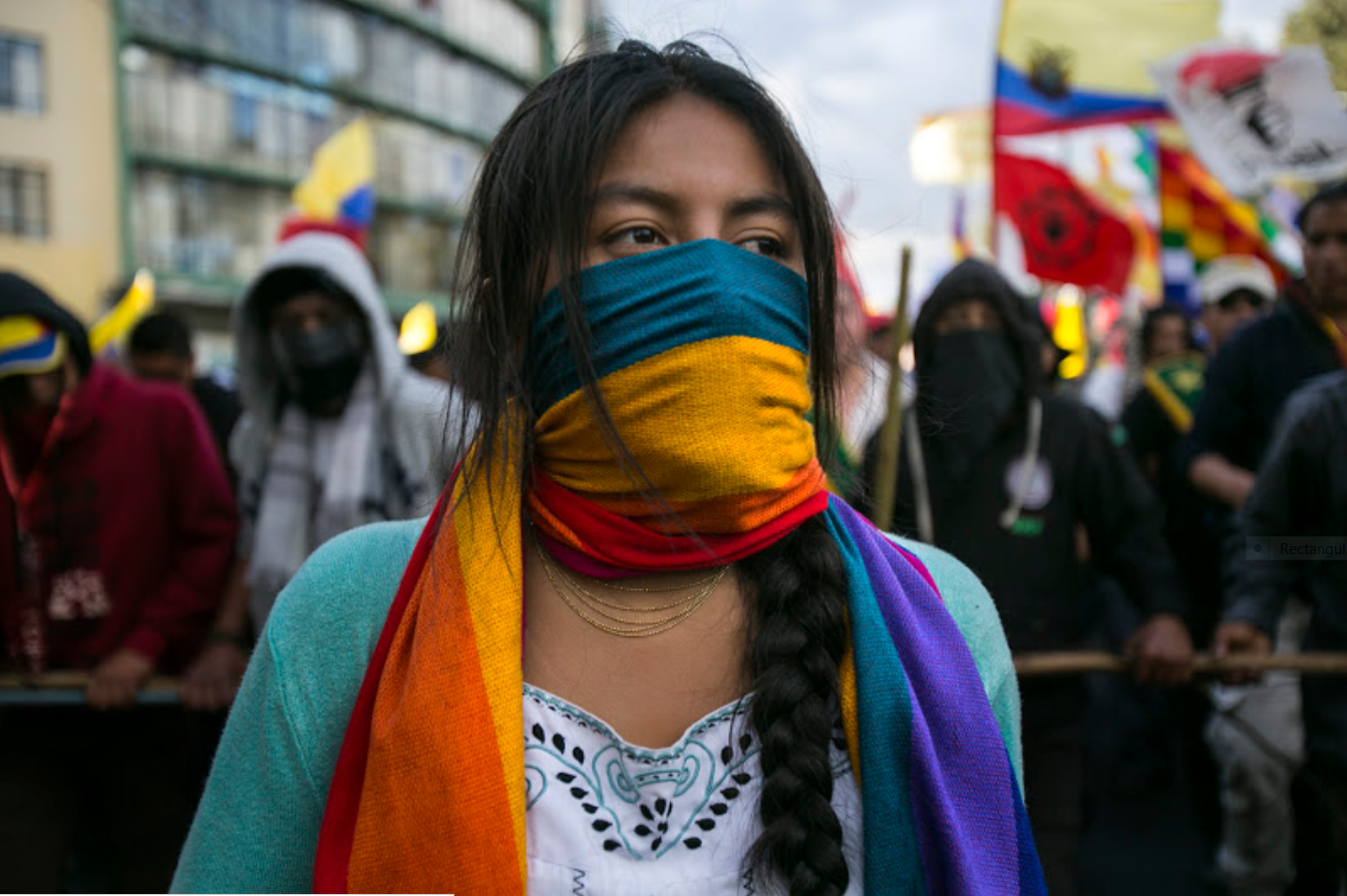 A woman at the indigenous march and People's Strike in Quito, Ecuador - www.jacobinmag.com