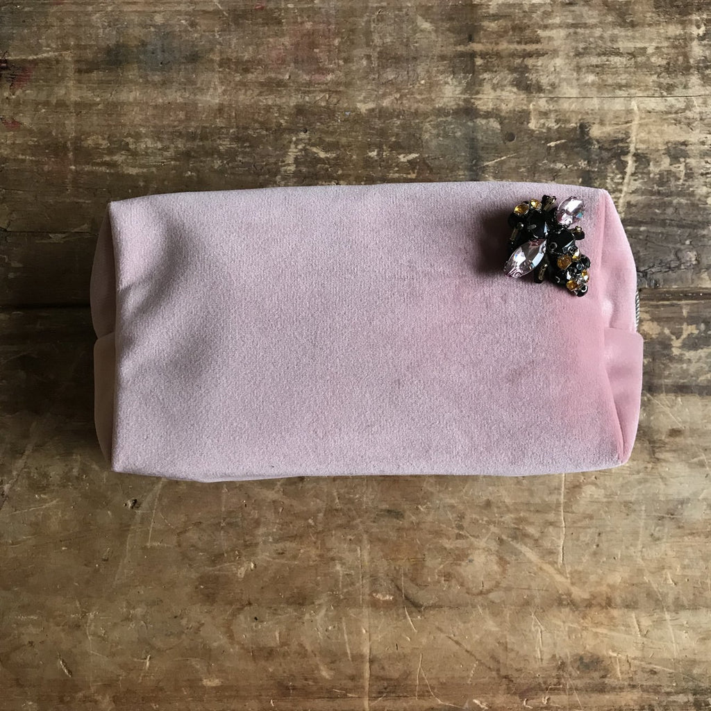 large powder pink make-up bag and bumblebee pin