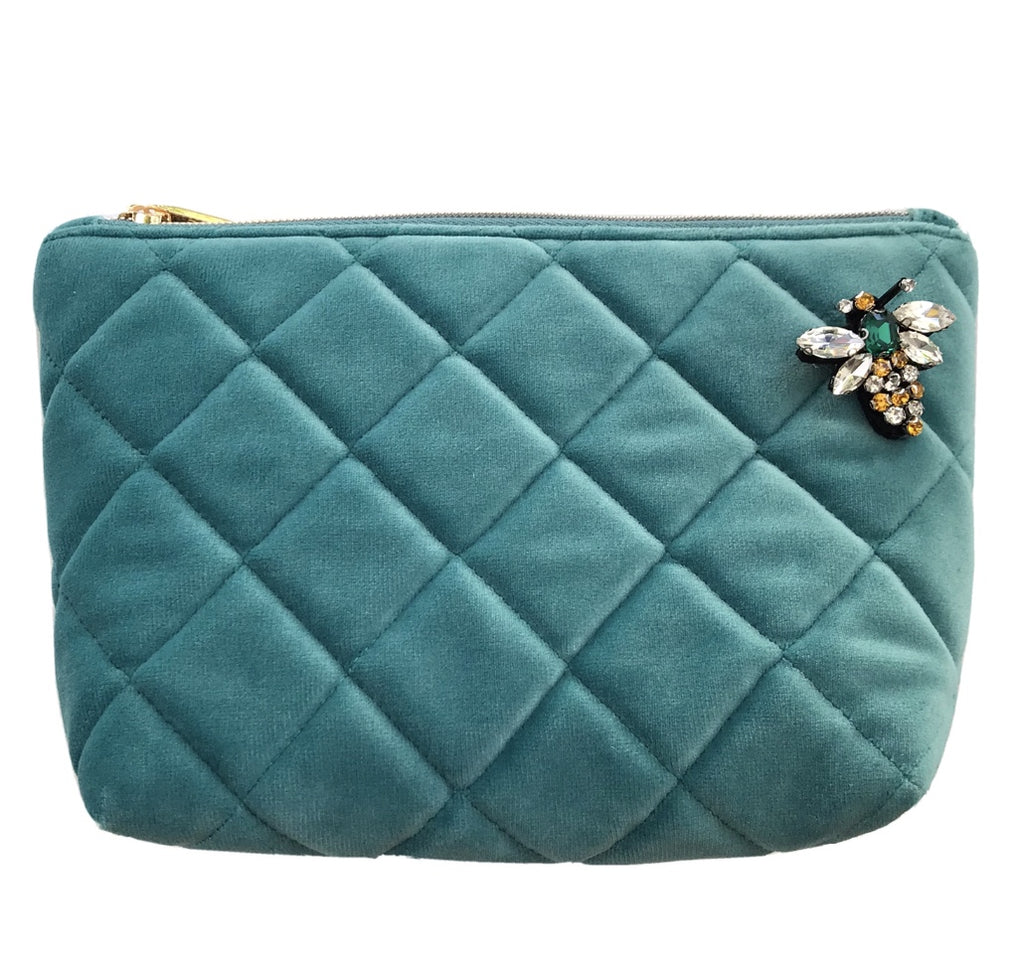 quilted make-up bag in duck egg blue velvet