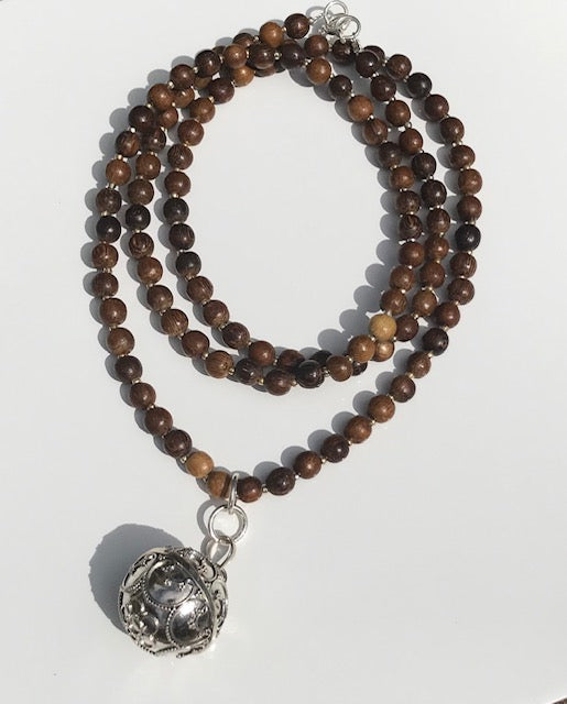 Wooden beads with a Goddess Harmony Ball