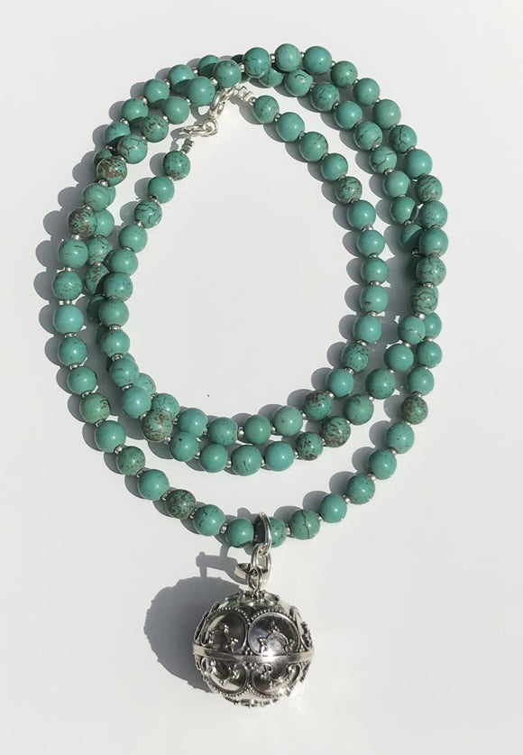 Turquoise beads with a Goddess Harmony Ball
