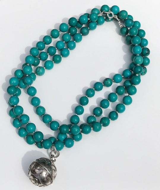 Turquoise howlite beads with a Goddess Harmony Ball