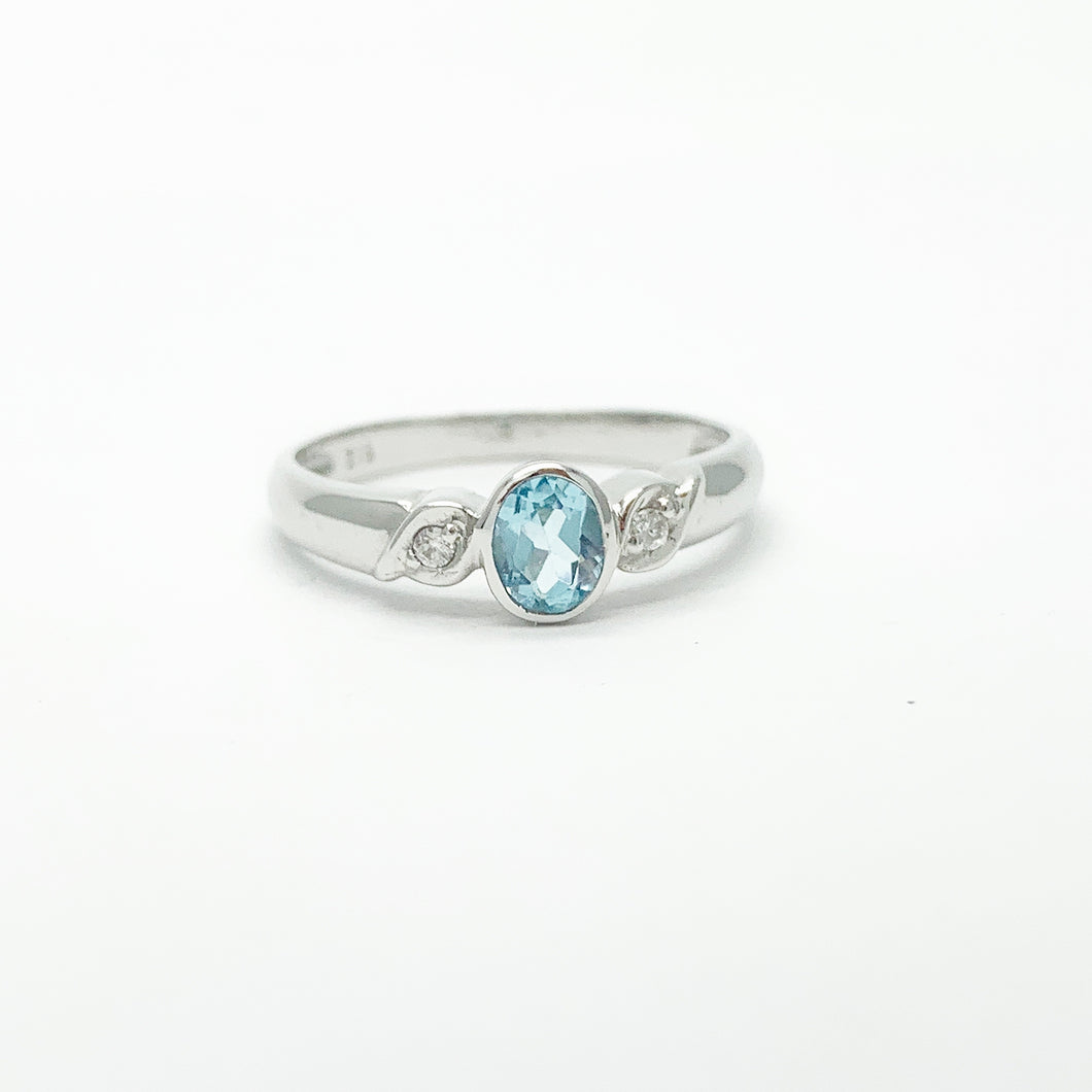 White Gold Topaz and Diamond Ring