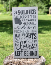 Load image into Gallery viewer, A Soldier Doesn't Fight Because He Hates What Is In Front Of Him He Fights Because He Loves What He Left Behind Wood Sign