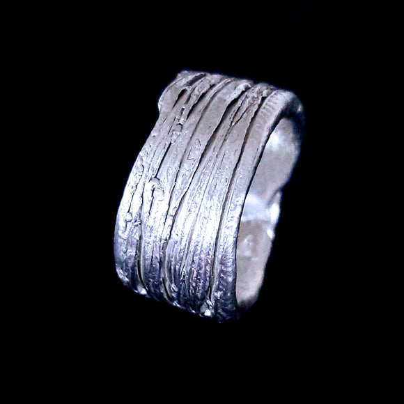This is a thick fine silver ring with a scratch texture running around it. Gem division jewellery, contemporary jewellery, organic jewellery, one off