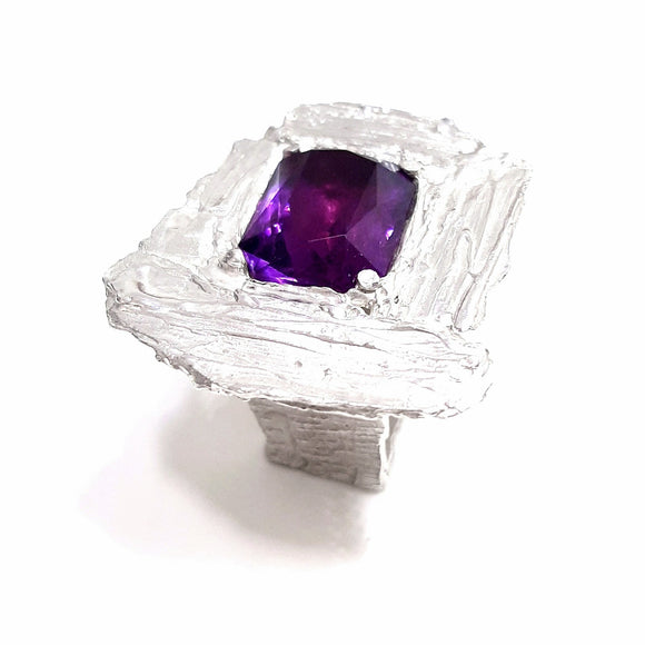 A large 17 x13 mm amethyst is set in a frame of molten sterling. Gem Division contemporary jewellery,  Wellington jeweller,  one off pieces,  art jewellery