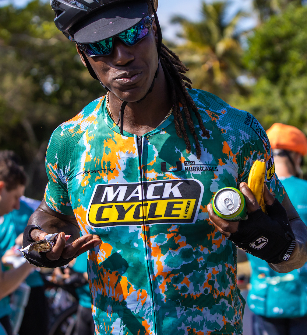 Man (Reese Whitely) shows of his Team Hurricanes Mack Cycle cycling jersey during the dolphins challenge Cancer