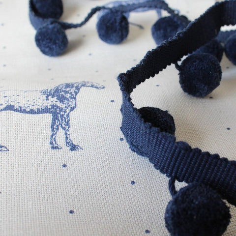 Blue pompon on coordinating fabric