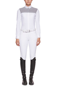 Cavalleria Toscana's new perforated show shirt range is a subtle twist of fashion and sophistication. The perforated fabric is across the front and the back. Using CT's Luxury jersey fabric this shirt fits perfectly, has great movement and breathability while looking great!  Style tip: Looks great with the matching grey CT breeches for young horse classes.   Comes in White Body with grey insert  Navy Body with white insert and white cuff (photo not shown)  CTSS21CAD178