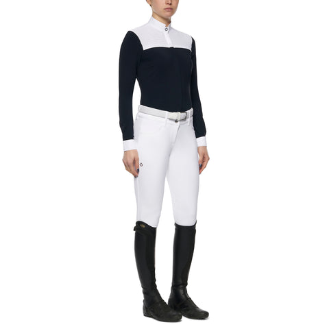 Cavalleria Toscana's new perforated show shirt range is a subtle twist of fashion and sophistication. The perforated fabric is across the front and the back. Using CT's Luxury jersey fabric this shirt fits perfectly, has great movement and breathability while looking great!  Style tip: Looks great with the matching navy CT breeches for young horse classes.   Also Comes in White Body with grey insert