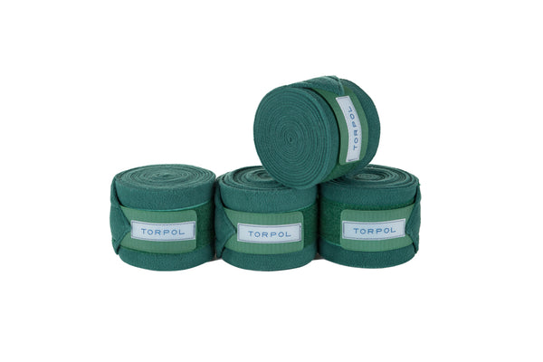 Torpol luxury equestrian fleece bandages in green. Matching items available