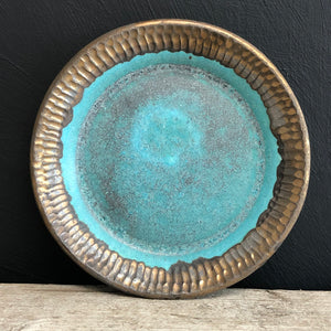 Turquoise and bronze plate with carving