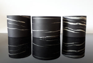 Group of small  black porcelain vessels