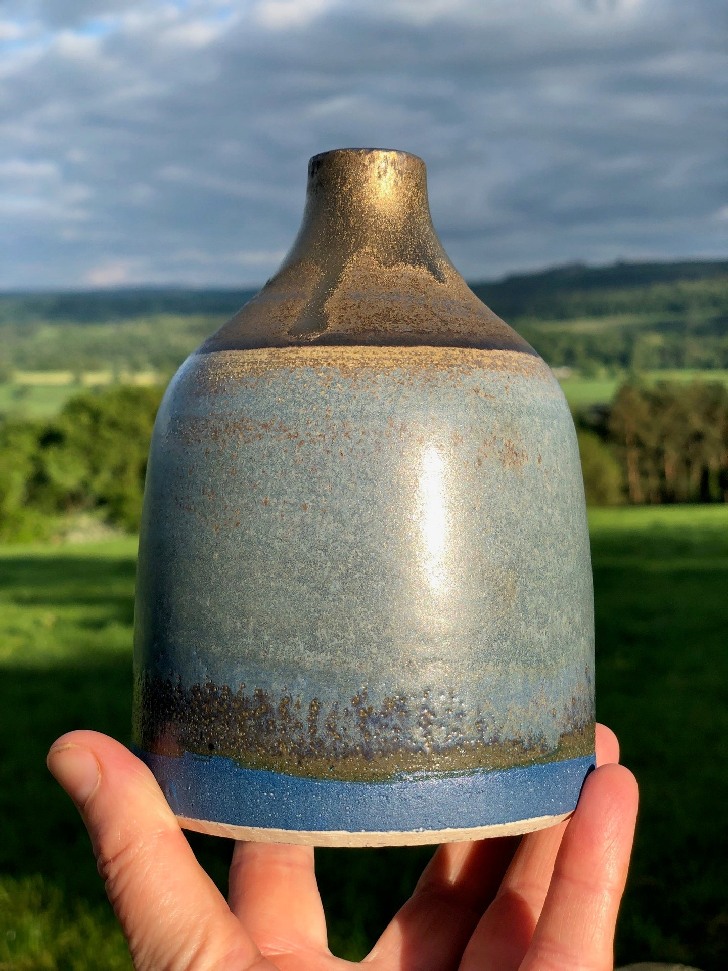 Stoneware bottle with cobalt and bronze glazes