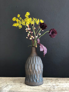 Black clay stoneware bottle bronze glaze
