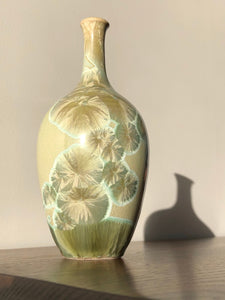 Small green crystalline vase