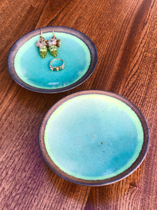 Tiny green dishes