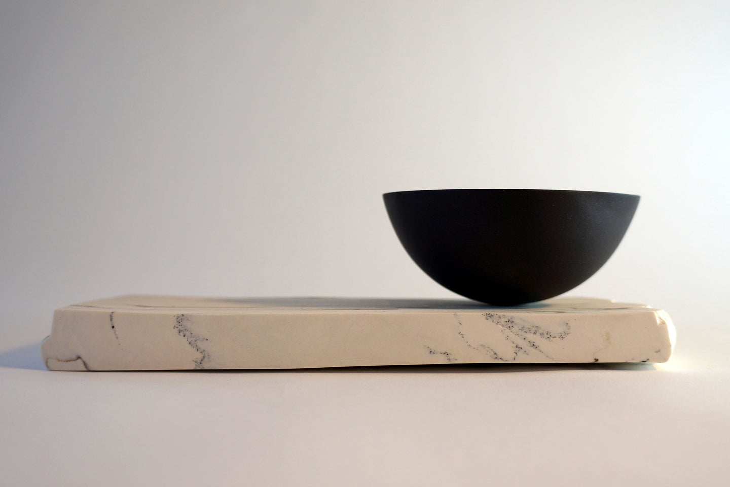 Black Porcelain Rocking Bowl on geological plinth