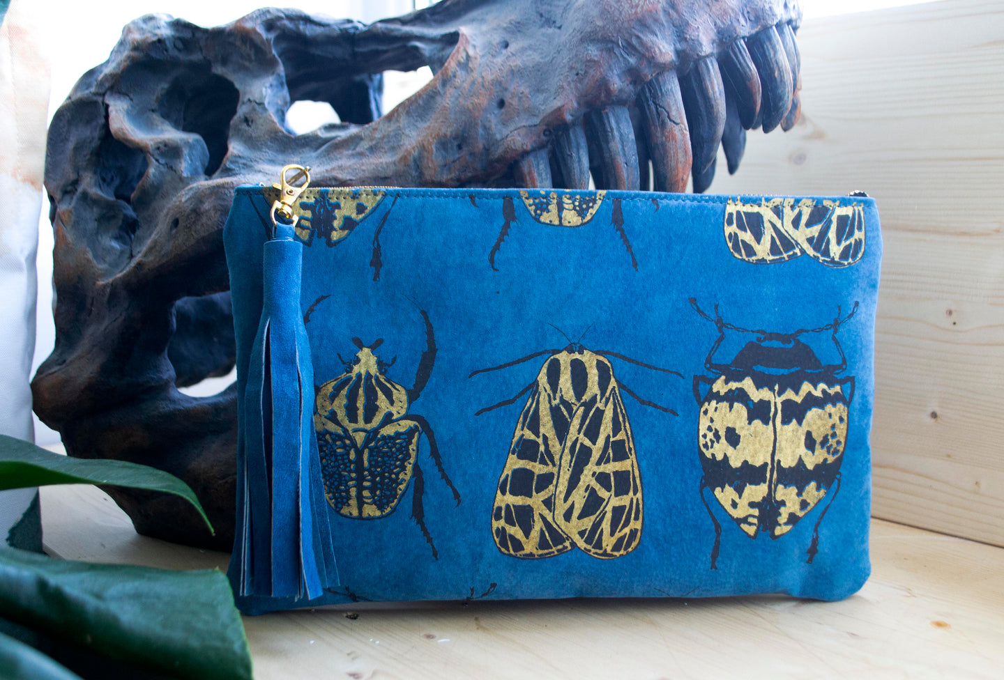 Mixed blue suede clutch
