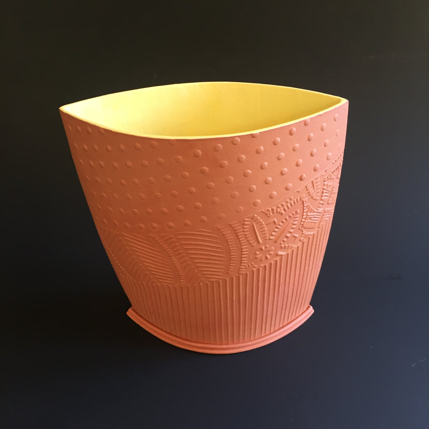 Terracotta vessel with yellow interior