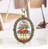 montre collier de poche flamant rose