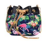 sac boule simili cuir chainette flamant rose