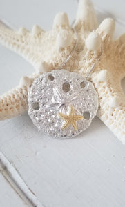 Sand dollar pendant - two tone with  2 starfishs