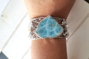 Larimar and pearl cuff with dolphins