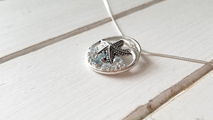 Knobby Starfish Pendant with Blue Topaz