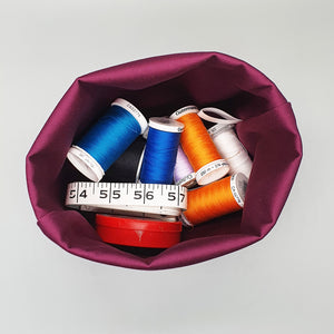 Interior of Labradors storage basket showing sewing supplies being stored
