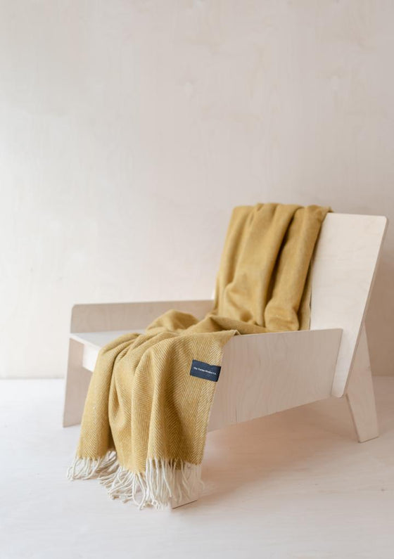 Ethically Made Recycled Wool Knee Blanket in Mustard Herringbone from Tartan Blanket Co. at Sancho's in Exeter, UK