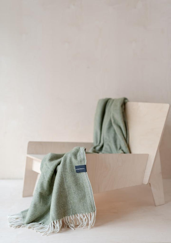 Ethically Made Recycled Wool Knee Blanket in Olive Herringbone from Tartan Blanket Co at Sancho's in Exeter, UK