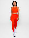Recycled PET Compressive High Rise Leggings in Daybreak Orange from Girlfriend Collective