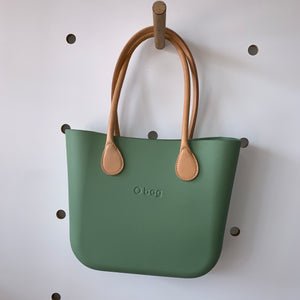 Sage Mini with natural leather handles.