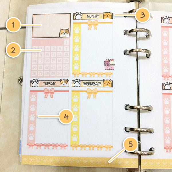 Kitty cat printable planner stickers on a planner spread.