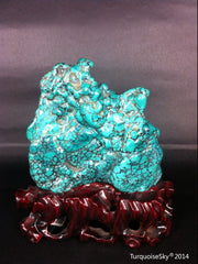 Natural blue turquoise stone with redwood stand 221.6 grams
