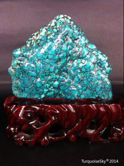 Natural blue turquoise stone with redwood stand 311.0 grams